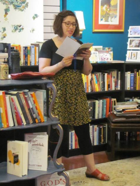 Deena November reading her poetry at Classic Lines bookstore.