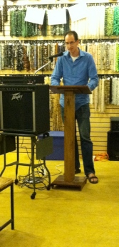 Ori Fienberg reading at Biddle's Escape. His poetry is featured in Issue 3.