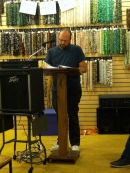 Scott Silsbe reading at Biddle's Escape. His poetry is featured in Issue 1.