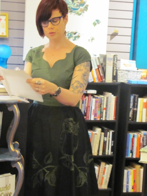 Jill Khoury reading her poetry at Classic Lines bookstore. Her poetry is featured in Issue 5.